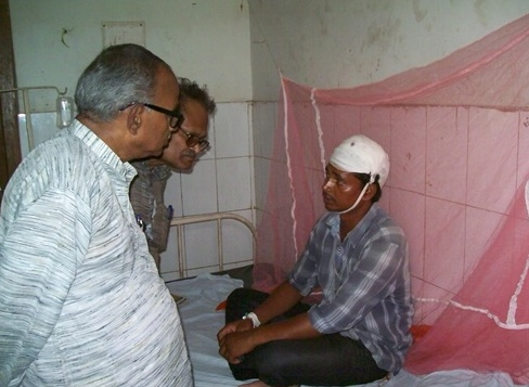 Bakshi with an Injured at the Hospital